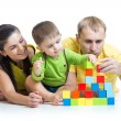 Kid with his parents play building blocks — Stock Photo #61631233