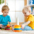 Children brothers play together in nursery — Stock Photo #61754043