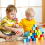 Kids playing in children room — Stock Photo #61920093