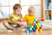 Kids playing in children room — Stock Photo