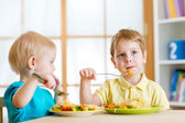 Kids eating in kindergarten or at home — Stock Photo