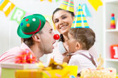 Family playing on child birthday — Stock Photo