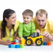 Kid with his parents play building blocks toys — Stock Photo #61966957