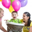 Family playing with son in flight on a makeshift balloon — Stock Photo #61992513