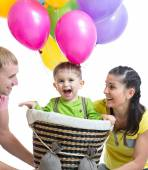 Family playing with son in flight on a makeshift balloon — Stock Photo