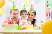 Happy parents celebrating birthday of kid son — Stock Photo
