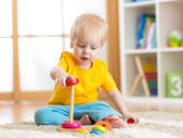 Cute kid playing with color toy indoor — Stockfoto
