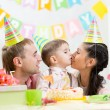 Parents kiss their son celebrating child birthday — Stock Photo #62166401