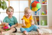 Children playing with soft ball in playroom — Foto de Stock