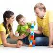 Kid with his parents playing building blocks — Stock Photo #62244133