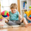 Kids boys play with ball indoor — Stock Photo #62260757