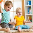 Kids playing with ball in playroom — Stock Photo #62312199