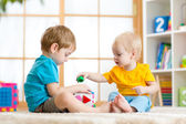 Little boys play together with educational toys — Stock Photo