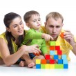 Kid with his parents play building blocks — Stock Photo #62330743
