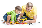 Kid and his dad repair toy tractor — Stock Photo