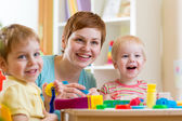 Woman playing and teaching children — Stock Photo