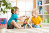 Children boys playing with abacus — Stock Photo
