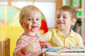 Children painting at home or playschool — Stock Photo
