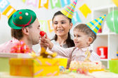 Family playing on child birthday — Stock Photo
