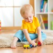 Kid boy playing with toys indoor — Stock Photo #62942559