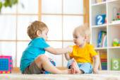 Kids play together with educational toys — Stock Photo
