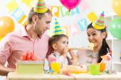 Family celebrating kids birthday — Stock Photo