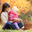 Kid and mother sit with apples — Stock Photo #63037233