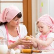 Mother and kid prepare cookies — Stock Photo #63037487