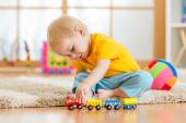 Child boy playing with toys indoor — Stock Photo