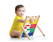 Baby playing with abacus toy — Stock Photo