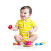 Baby boy playing with colorful toy — Stock Photo