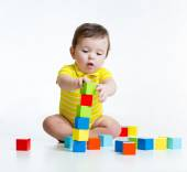 Kid boy playing wooden toys — Stock Photo