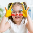 Cute child have fun painting her hands — Stock Photo #63951577