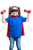 Child girl plays superhero and lifts dumbbells — Stock Photo