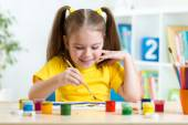 Kid painting at home or day care center — Stock Photo