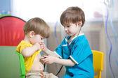 Children boys play doctor — Stock Photo