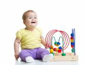 Baby boy playing with educational toy — Stock Photo