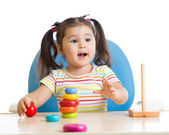 Child playing with color pyramid toy — Stock Photo