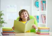 Child with opened book — Stock Photo