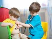 Children boys play doctor — Stock Photo
