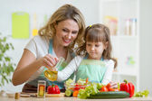 Mom and girl  preparing healthy food — Stock Photo