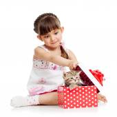 Girl opening gift box with kitten — Stock Photo