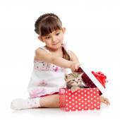 Girl opening gift box with kitten — Stock Photo