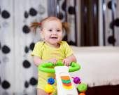 Cute baby standing with support — Stock Photo