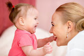 Mom looks with love at baby. Parenthood happiness conception. — Stockfoto