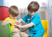 Children boys play doctor at home — Foto Stock