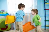 Two children playing with pillows — Stock Photo