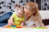 Mother and kid boy play together indoor — Stock Photo