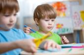 Kids boys painting in nursery at home — Stock Photo