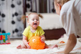 Mom playing ball with baby indoor — Stock Photo